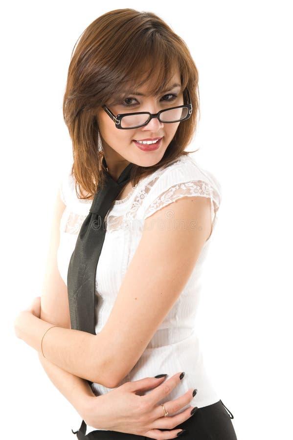 Schöne Geschäftsfrau, die Kamera betrachtet. stockfoto