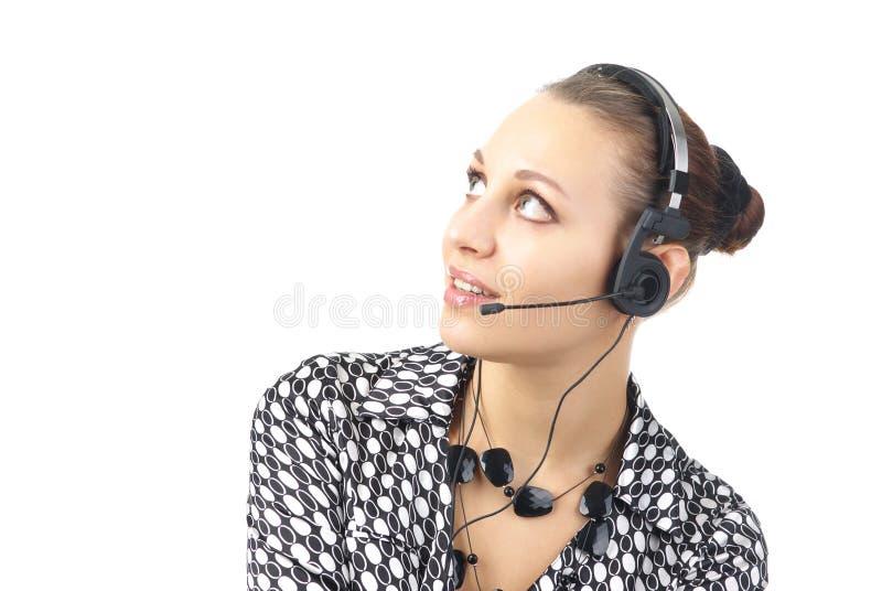 Schöne Geschäftsfrau mit Kopfhörer lizenzfreie stockfotos