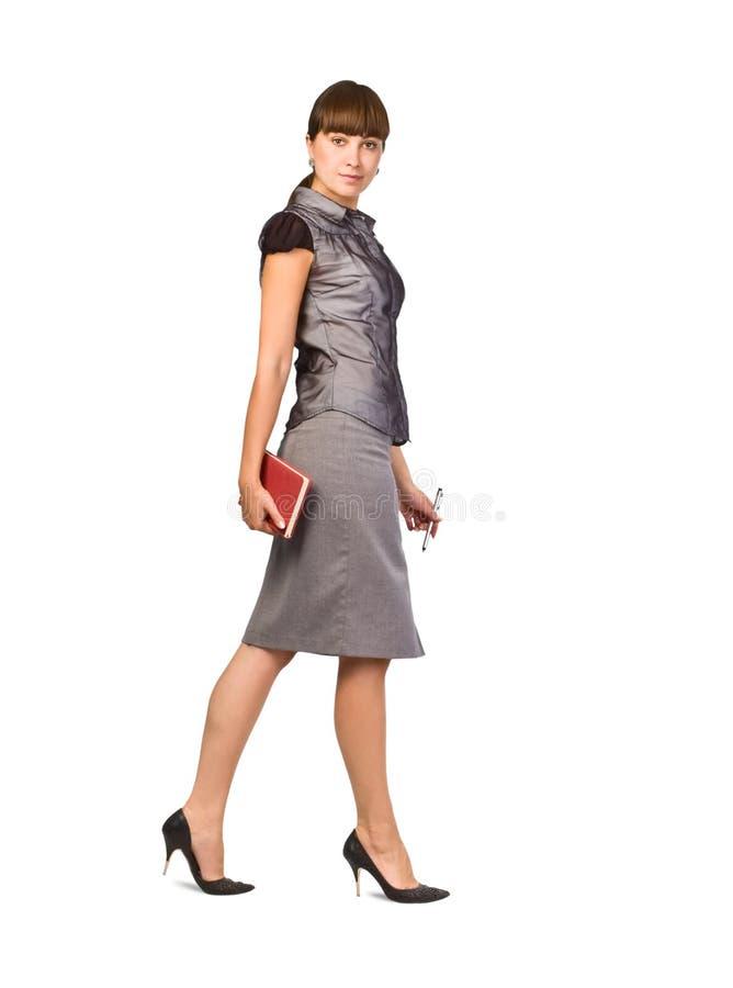 Schöne Geschäftsfrau mit Tagebuch und Feder stockbild