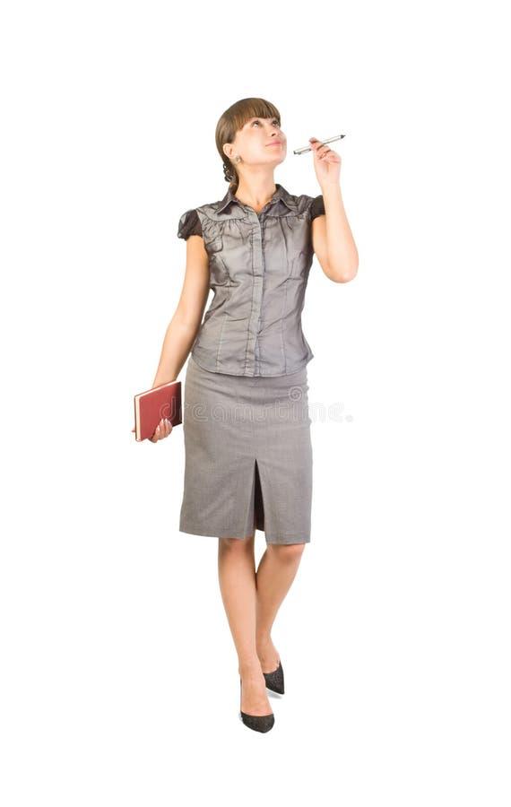 Schöne Geschäftsfrau mit Tagebuch und Feder stockfotos