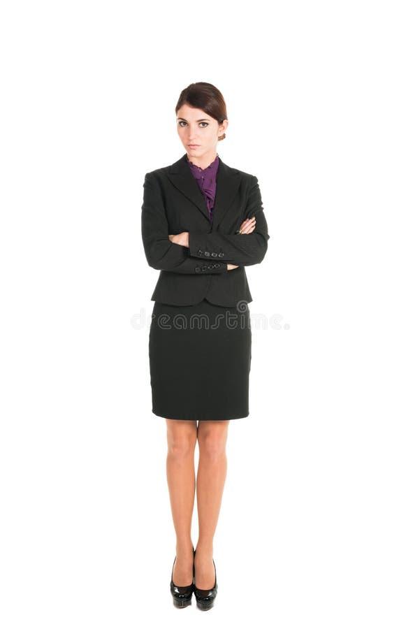Schöne Geschäftsfraustellung lokalisiert lizenzfreie stockfotos