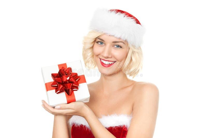 Schöne junge blonde Frau als Sankt-Mädchen mit Geschenk stockfotografie