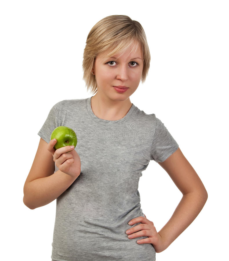 Schöne junge Frau, die grünen Apfel anhält stockfotos