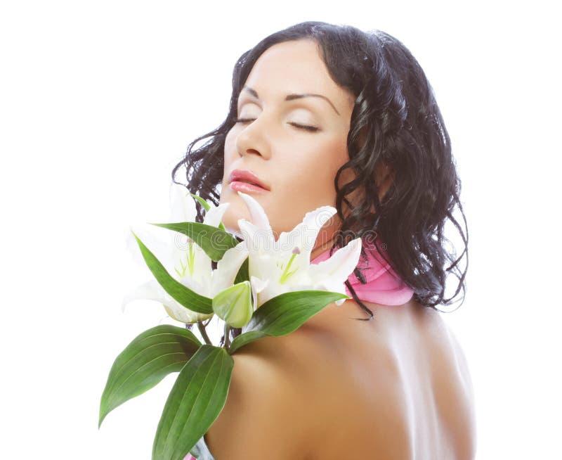 Schöne junge Frau mit Blume stockfoto
