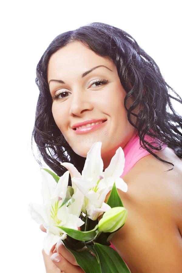 Schöne junge Frau mit Blume stockfotos