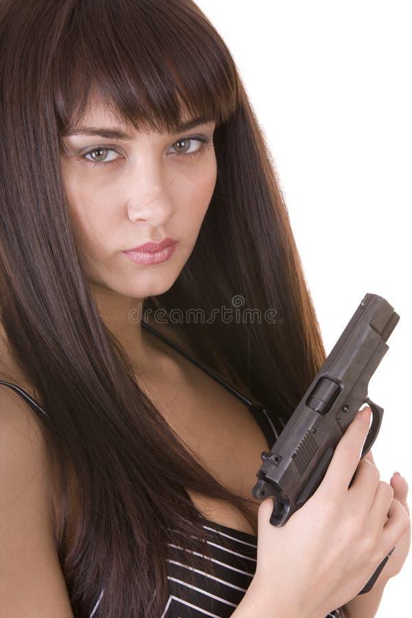 Schöne junge Frau mit Gewehr. lizenzfreies stockbild