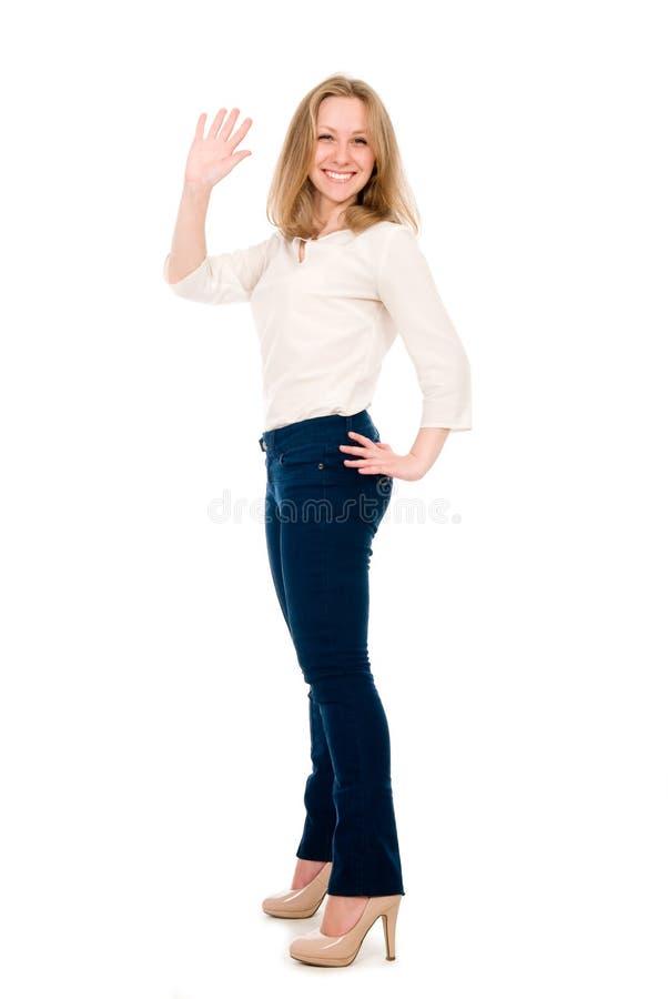 Schöne junge Frauen, die ihre Hand wellenartig bewegen. lizenzfreie stockbilder