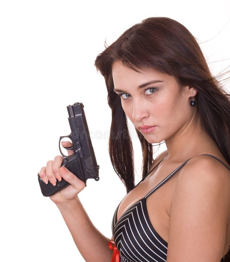 Schöne junge Frauen mit Gewehr. stockbilder