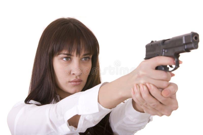 Schöne junge Frauen mit Gewehr. stockbild