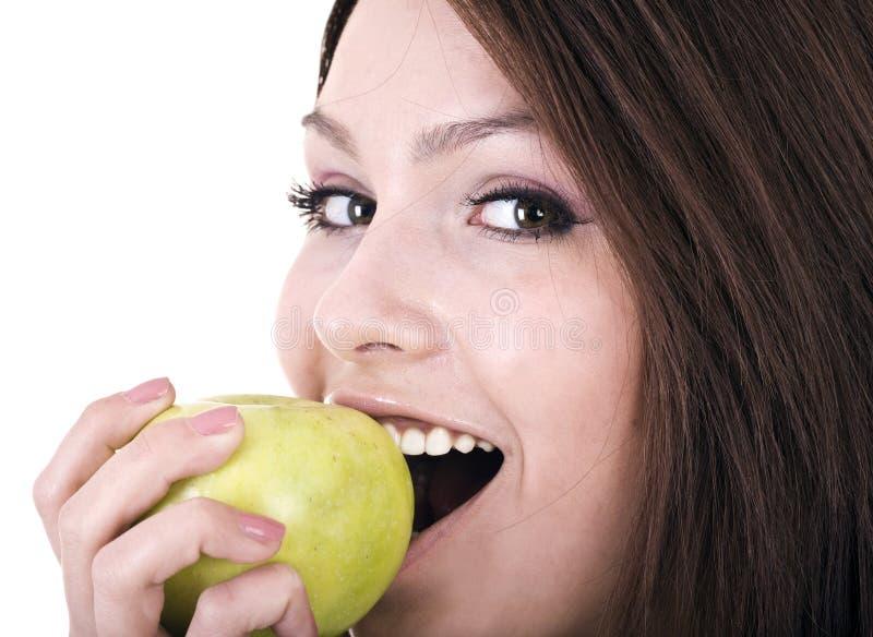 Schöne junge Frauen mit grünem Apfel. lizenzfreie stockbilder
