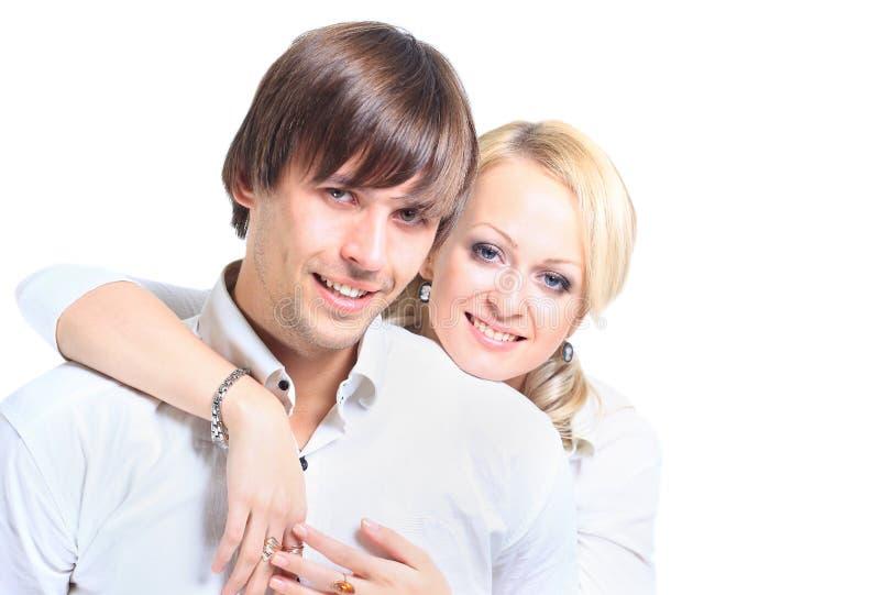 Schöne junge glückliche lächelnde Paare lizenzfreies stockbild