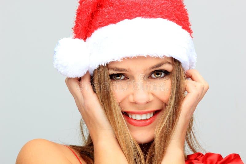 Schöne junge glückliches Weihnachtsfrau lizenzfreie stockfotografie