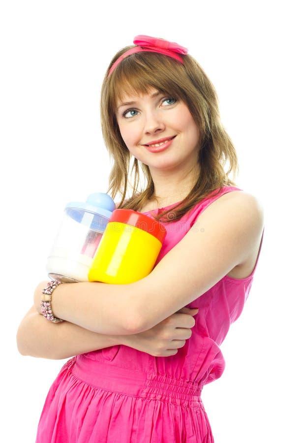 Schöne junge Hausfrau lizenzfreie stockbilder