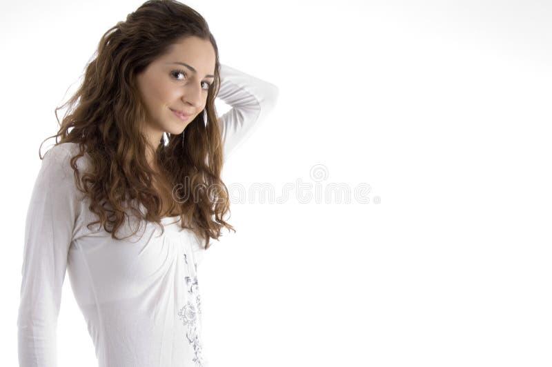 Schöne junge moderne Mädchenaufstellung stockfotos