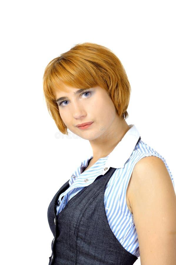 Schöne junge rote Frau lizenzfreies stockbild
