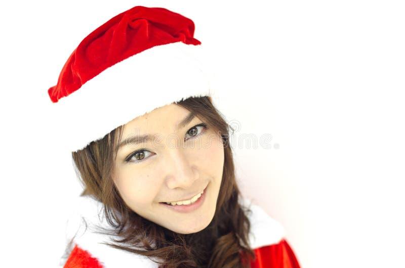 Schöne junge Weihnachtsmann-Frau, stockfoto