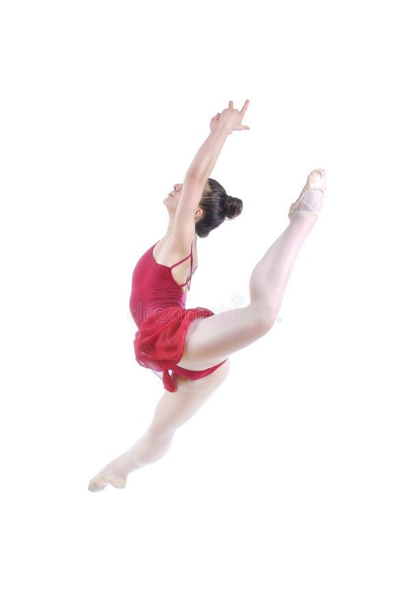 Schöne künstlerische weibliche Ballerina, die, Ballettelement durchführend ausarbeitet stockbild