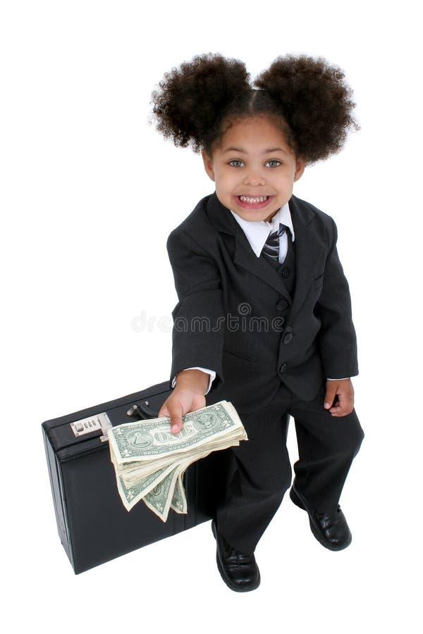 Schöne kleine Geschäftsfrau mit Aktenkoffer und Geld lizenzfreies stockbild
