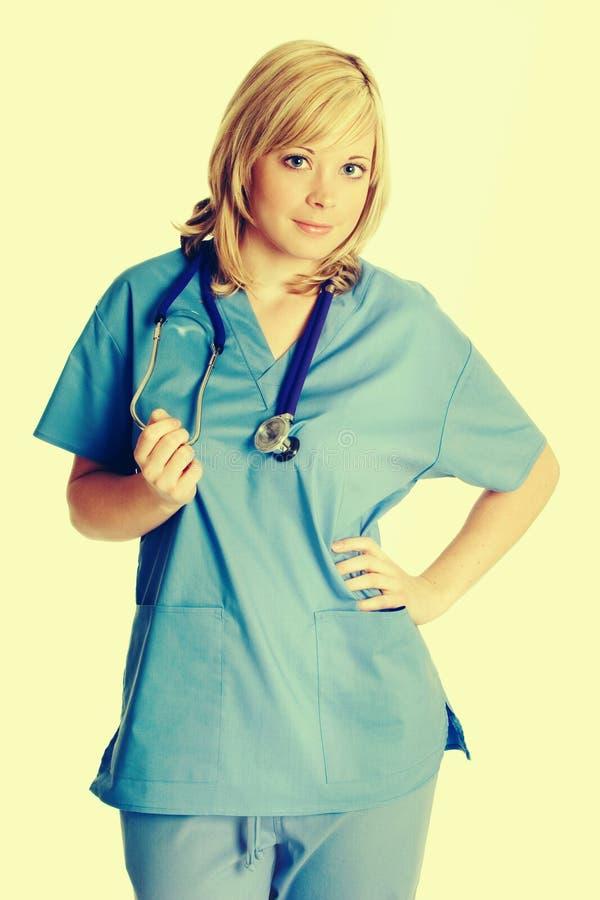 Schöne Krankenschwester mit Stethoskop stockbilder
