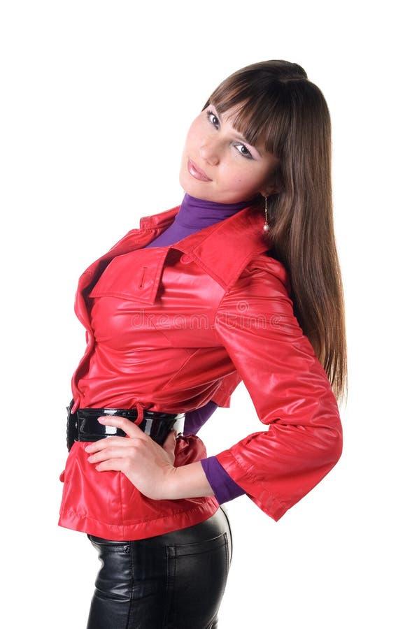 Schöne lächelnde Frau in den ledernen Hosen. stockfotografie