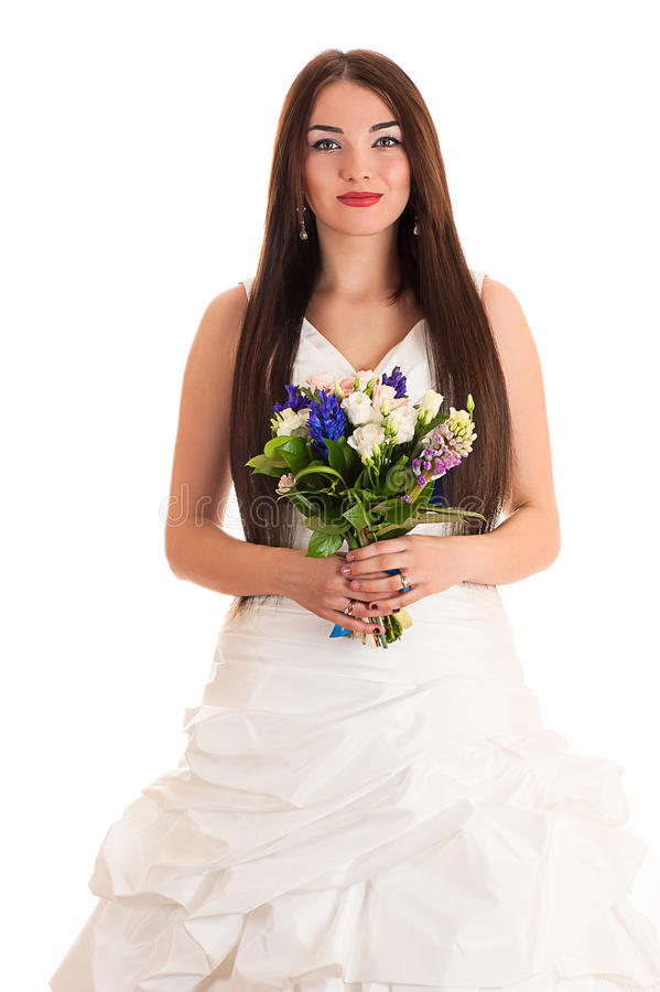 Schöne lächelnde Frau in einem Hochzeitskleid lizenzfreie stockfotografie