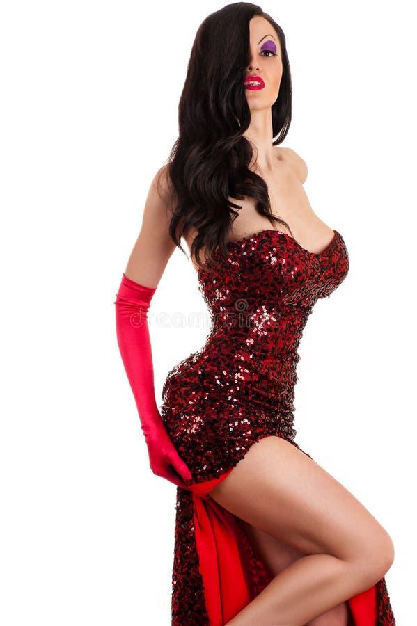 Schöne leidenschaftliche Frau in einem roten Kleid lizenzfreies stockbild
