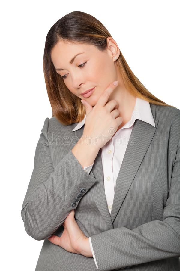 Schöne nachdenkliche Geschäftsfraufrau mit Berufskleidung lizenzfreie stockbilder