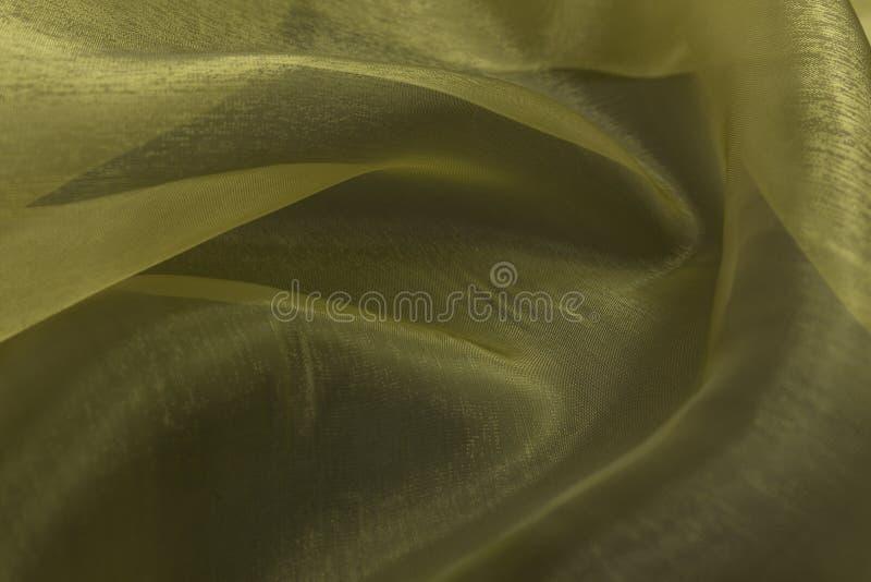 Schöne Nahaufnahme des gelben Baumwollsatingewebes mit Textilbeschaffenheitshintergrund stockbild