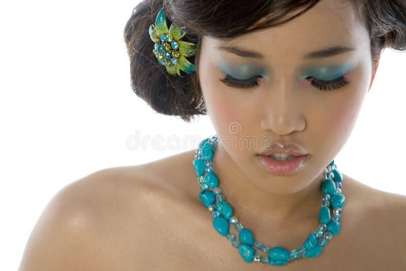 Schöne reizvolle asiatische Frau lizenzfreie stockbilder