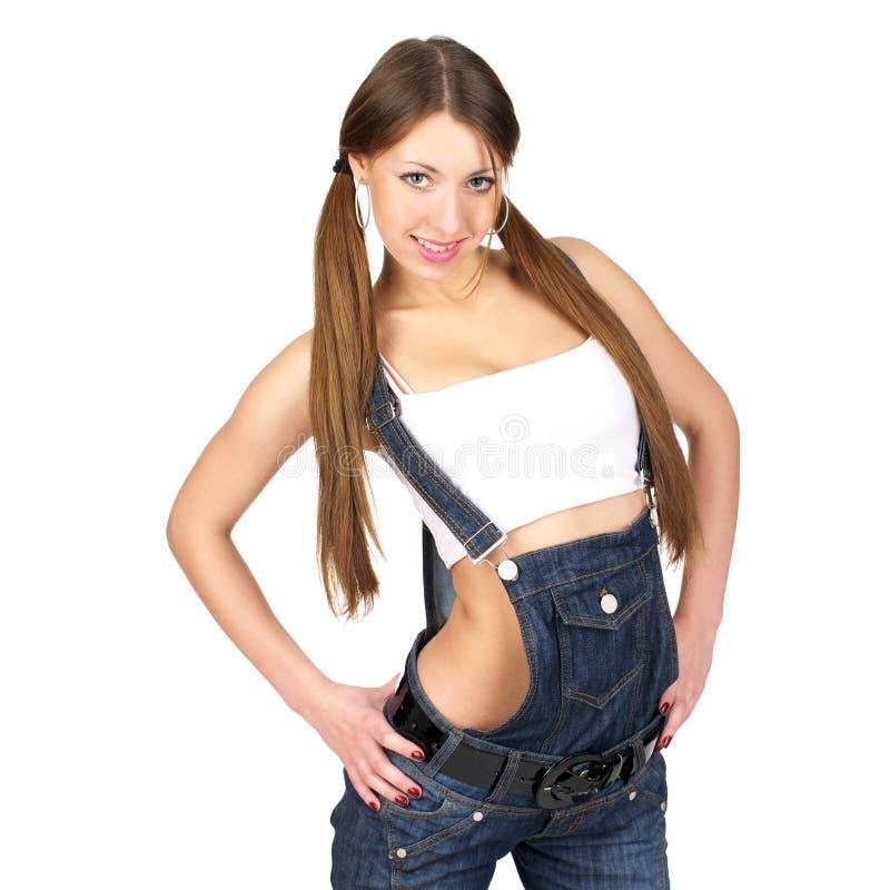 Schöne reizvolle Frau in den Jeans lizenzfreie stockfotografie