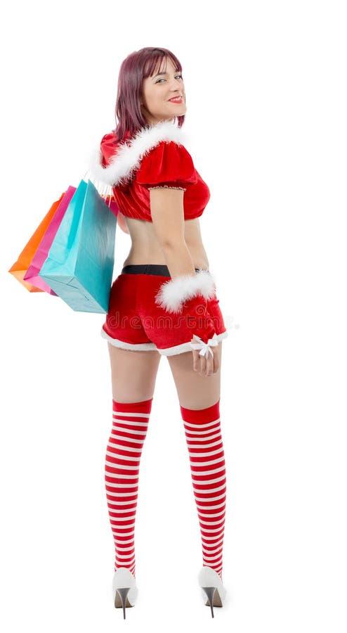Schöne Santa Claus-Frau, die Einkaufstaschen hält lizenzfreies stockbild