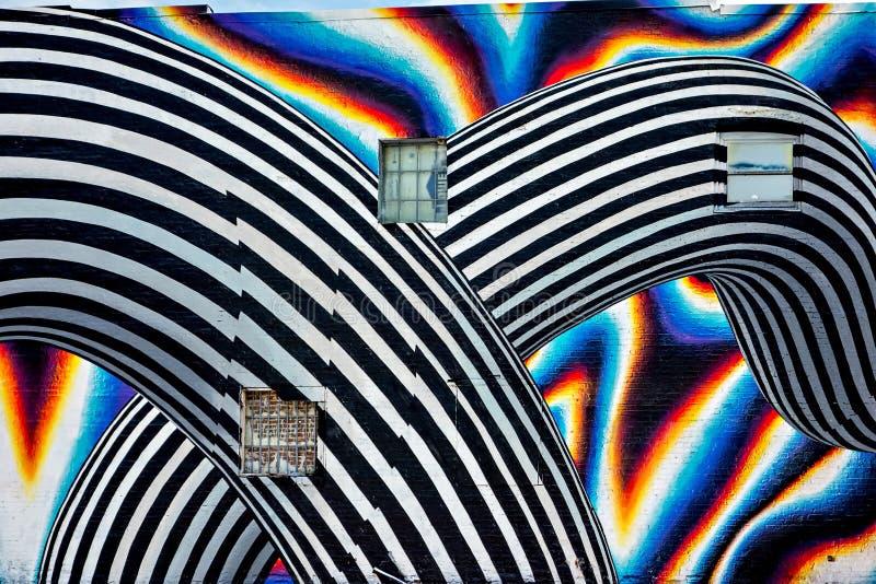 Schöne Straßenkunst von Graffiti Abstrakte Farbekreatives drawin stockbilder