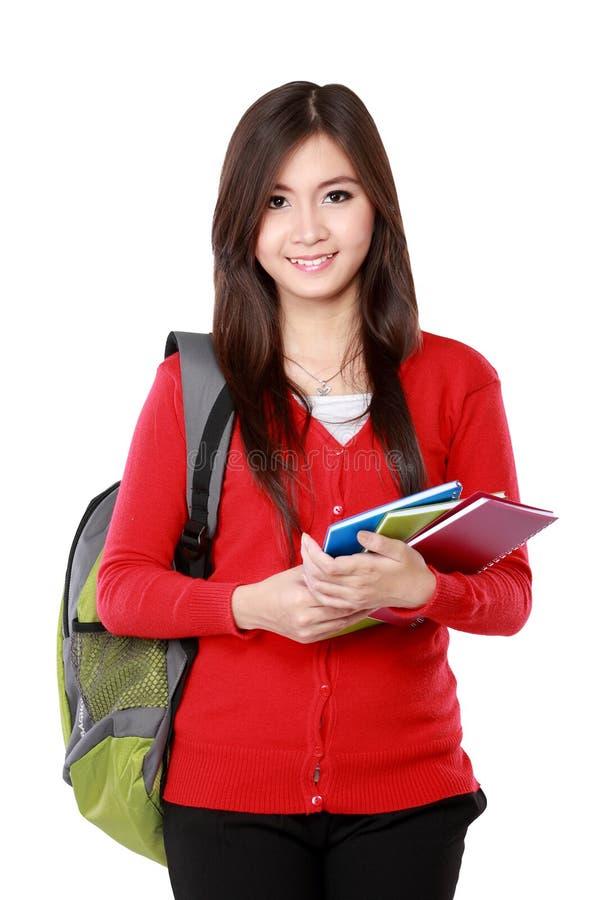 Schöne Studentin mit dem Buchlächeln lizenzfreies stockfoto