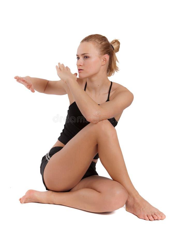 Schöne tragende Trainingskleidung der jungen Frau. lizenzfreie stockfotografie