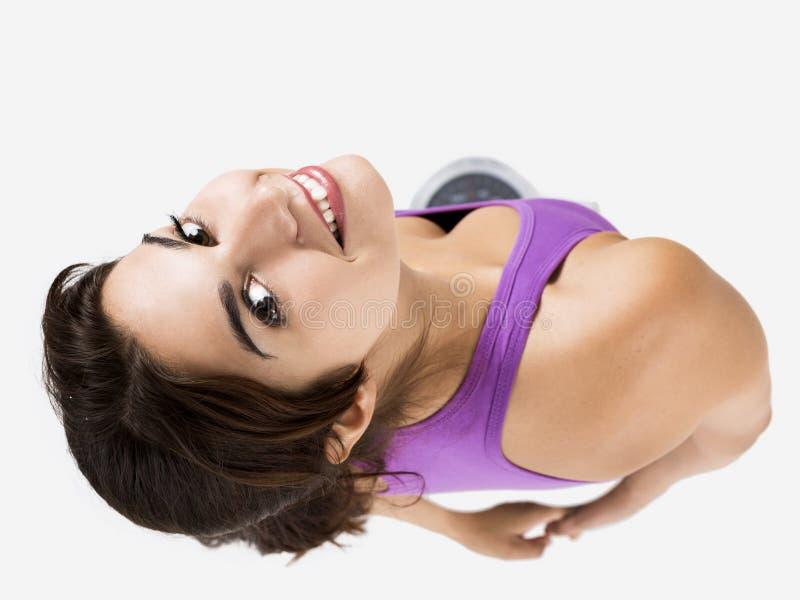Schöne und glückliche athletische Frau stockfotografie