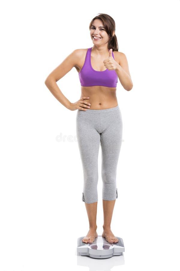Schöne und glückliche athletische Frau lizenzfreie stockfotografie