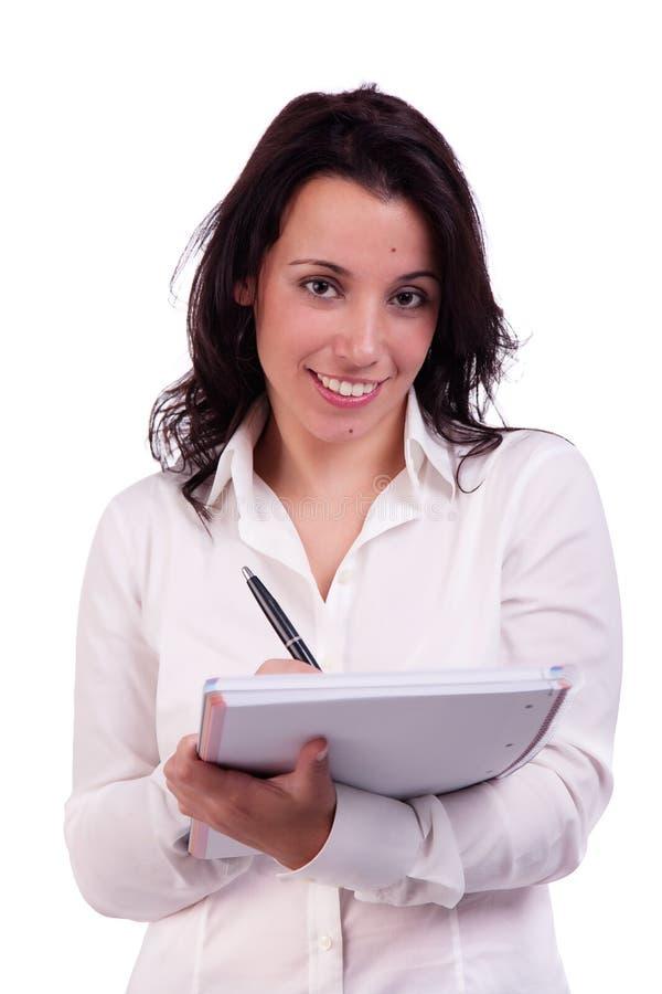 Schöne und glückliche Geschäftsfrau, die Kenntnisse nimmt lizenzfreie stockfotografie