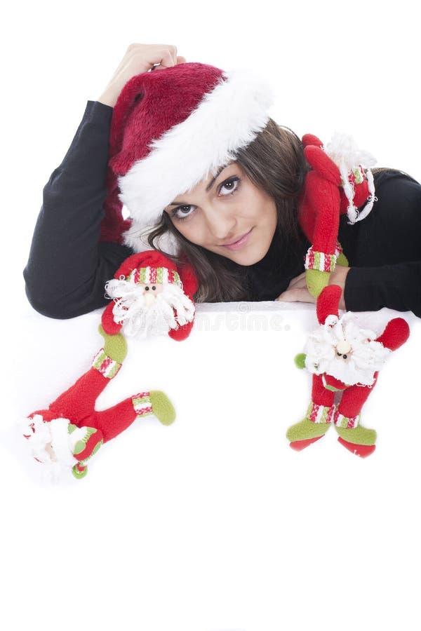 Schöne Weihnachtsfrau im Sankt-Hut lizenzfreie stockfotografie