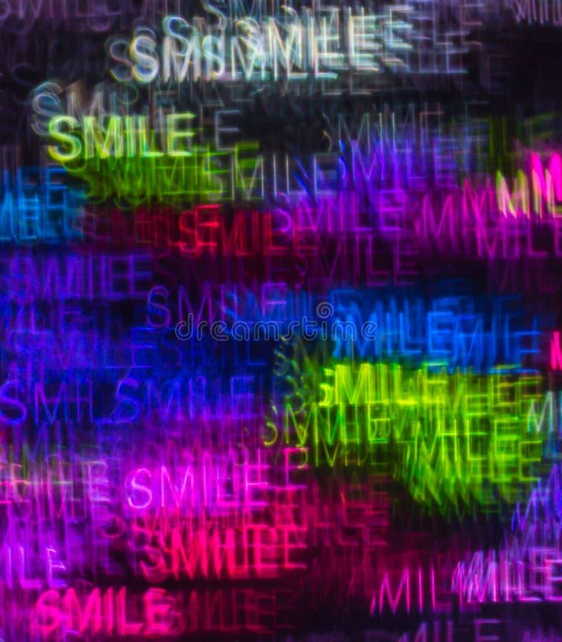 Schöner Hintergrund mit dem unterschiedlichen farbigen Wortlächeln, abstrakt stockfoto