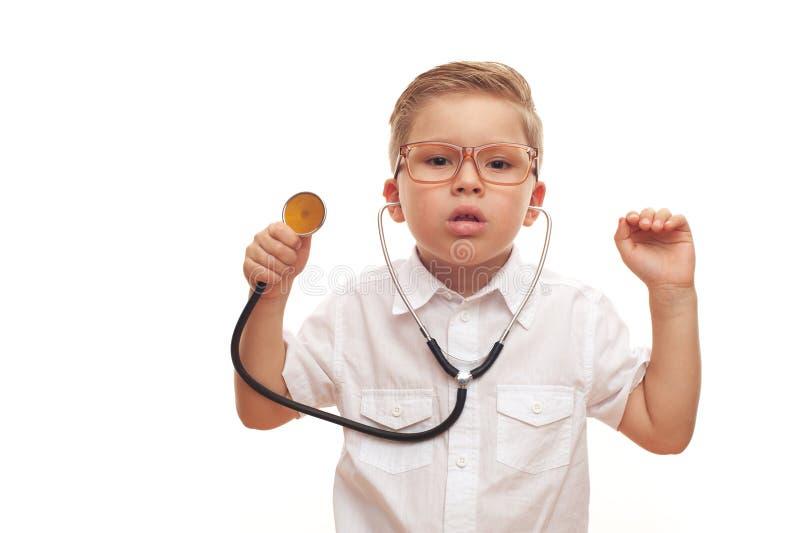 Schöner intelligenter Zukunftdoktor des kleinen Jungen stockbild
