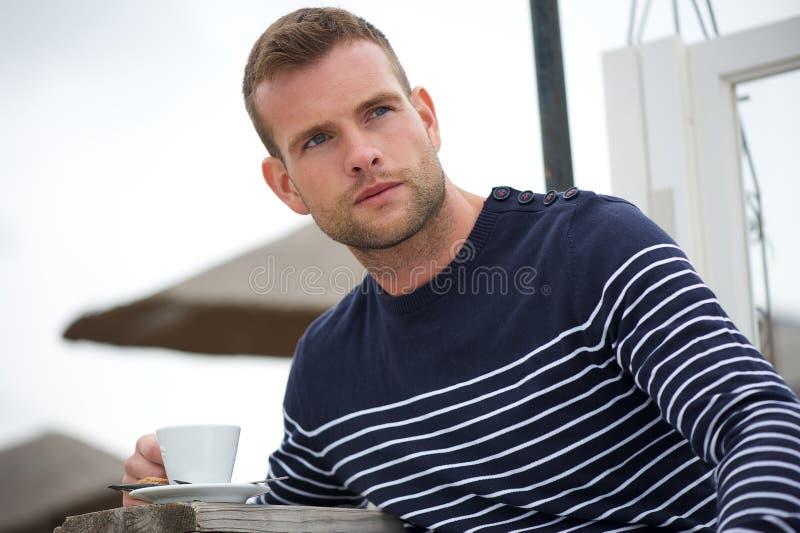 Download Schöner Junger Mann Mit Seinem Kaffee Stockfoto - Bild von attraktiv, geschmack: 26374214