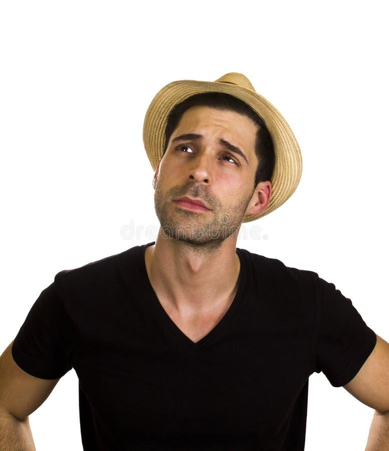 Schöner junger Mann trägt Hut stockbild
