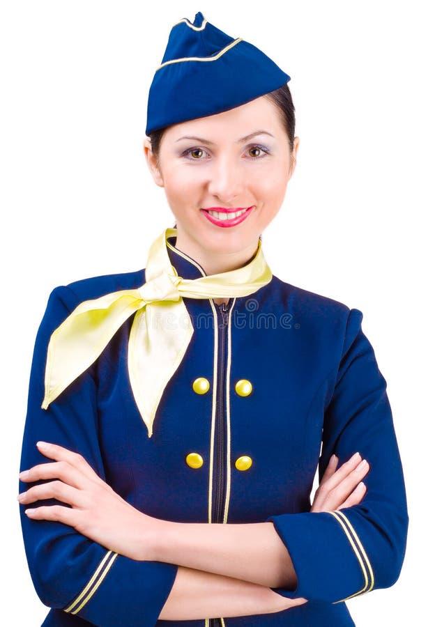 Schöner lächelnder Stewardess lizenzfreie stockbilder