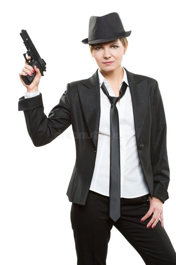 Schöner Mädchengangster, der ein Gewehr hält klassisch lizenzfreies stockfoto