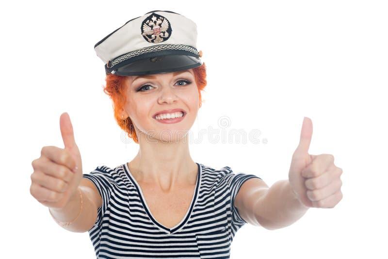 Schöner Seemann, der sich Daumen zeigt lizenzfreies stockbild