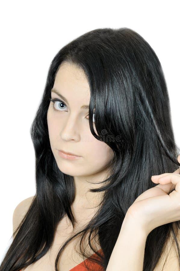 Schöner trauriger Brunette mit dem langen Haar lizenzfreie stockfotos