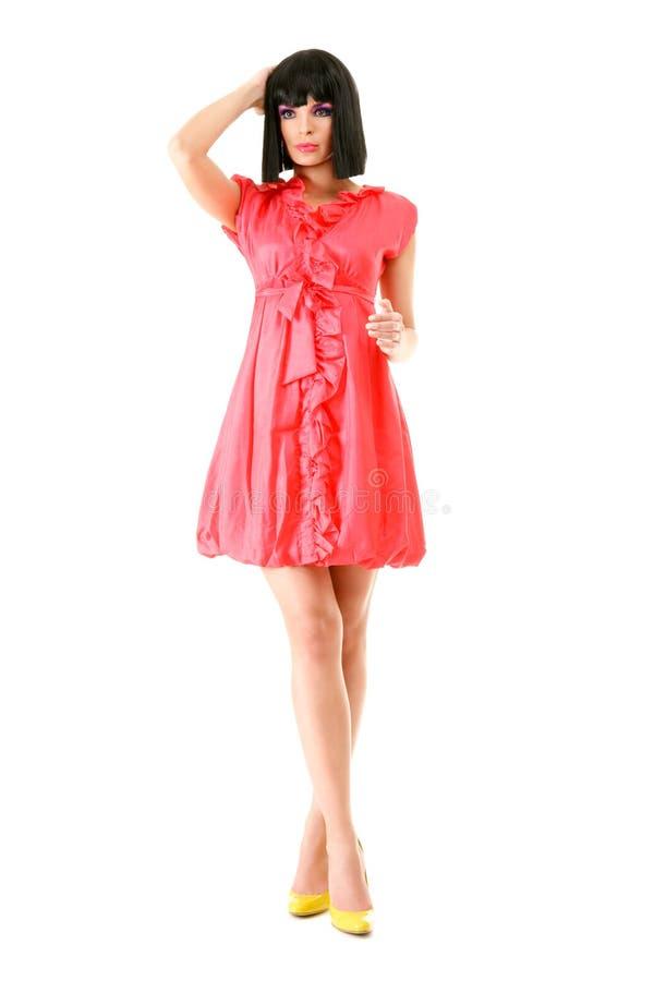 Schönes Art und Weisebaumuster im rosafarbenen Minikleid stockfotos