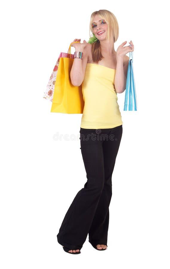 Schönes blondes Fraueneinkaufen stockbild
