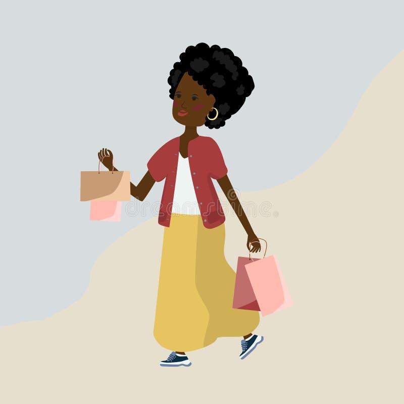 Schönes dunkelhäutiges Mädchen mit Paketen vom Speicher lizenzfreies stockfoto