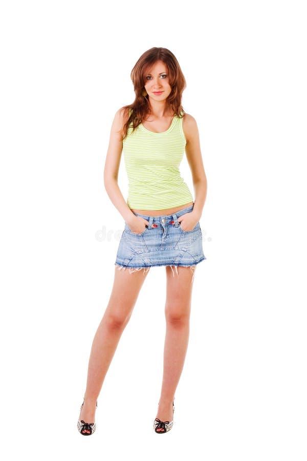 Schönes entzückendes junges Mädchen im Denimrock lizenzfreie stockfotografie